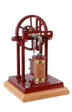 A well engineered model of an over-type vertical live steam cross engine