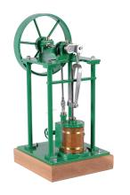 A well engineered model of an over-type vertical live steam engine