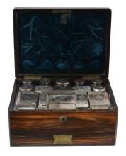 A Victorian coromandel dressing case with silver mounted fittings