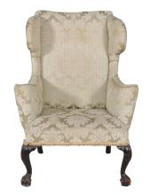 A mahogany and upholstered wing armchair in George I style , early 20th century