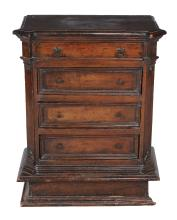 An Italian walnut chest of drawers , first quarter 18th century