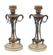 A pair of Empire bronze and gilt metal mounted candlesticks, early 19th century
