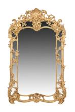 A carved giltwood & composition wall mirror in French early 19th century style