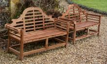 A pair of teak garden seats in the manner of designs by Lutyens
