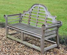 A teak garden seat in the manner of designs by Lutyens, of recent manufacture