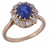 A sapphire and diamond cluster ring, the oval cut