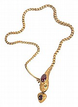A mid Victorian gold, garnet and emerald serpent