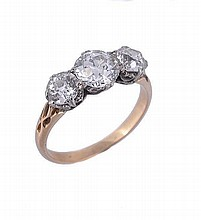 An early 20th century three stone diamond ring,