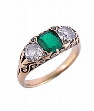 A late Victorian three stone emerald and diamond