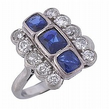A sapphire and diamond panel ring, circa 1930, the