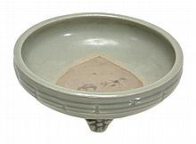 A Longquan celadon tripod censer raised on three
