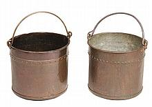 A matched pair of wrought iron mounted copper coal