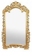 A composition gilt floor standing mirror, in