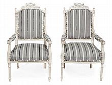 A pair of carved and painted wood and upholstered