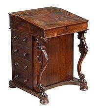 A Victorian rosewood Davenport, circa 1870, the