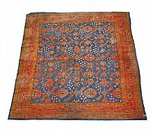 An Ushak carpet, blue field with all-over paterae