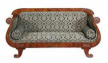 A mahogany and upholstered sofa, in Empire style,
