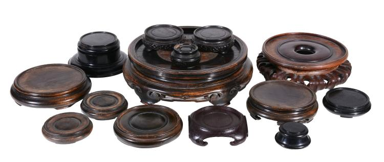Fifteeen various Chinese hardwood stands, 30cm diameter and smaller (15)