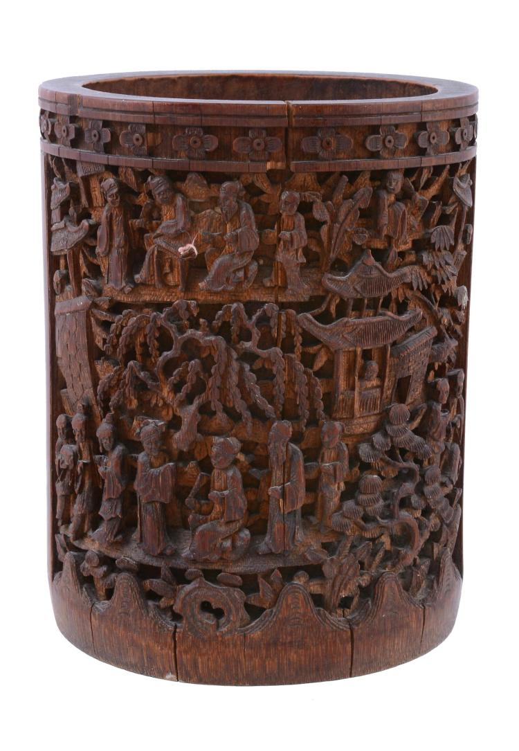 A Chinese bamboo brush pot, 19th century, carved with a large panel of...
