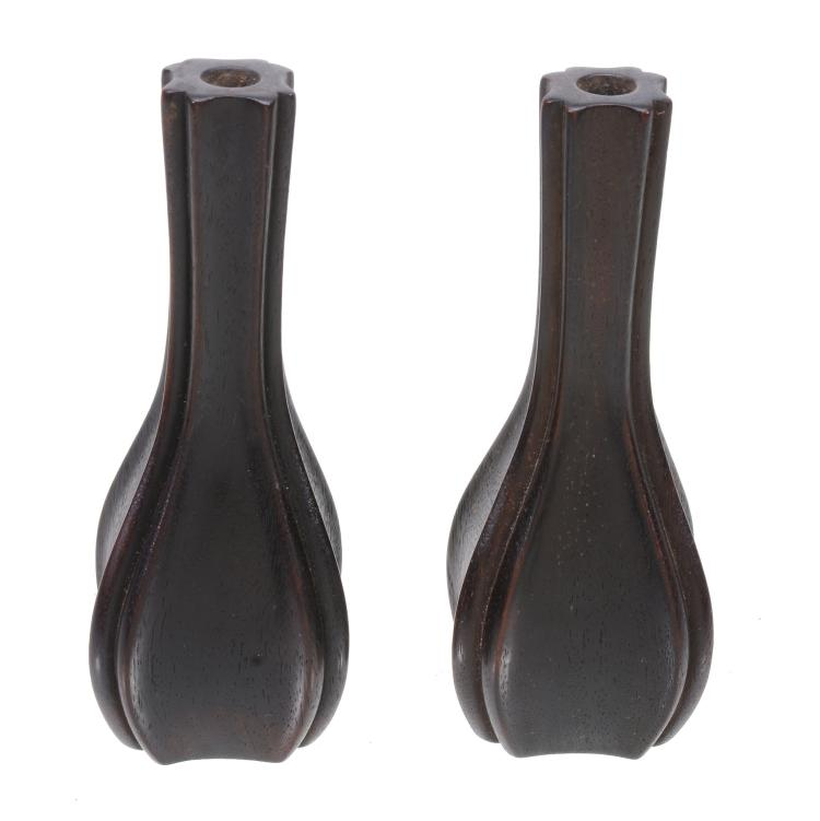 A small pair of Chinese hardwood vases , of ovoid form with tall neck