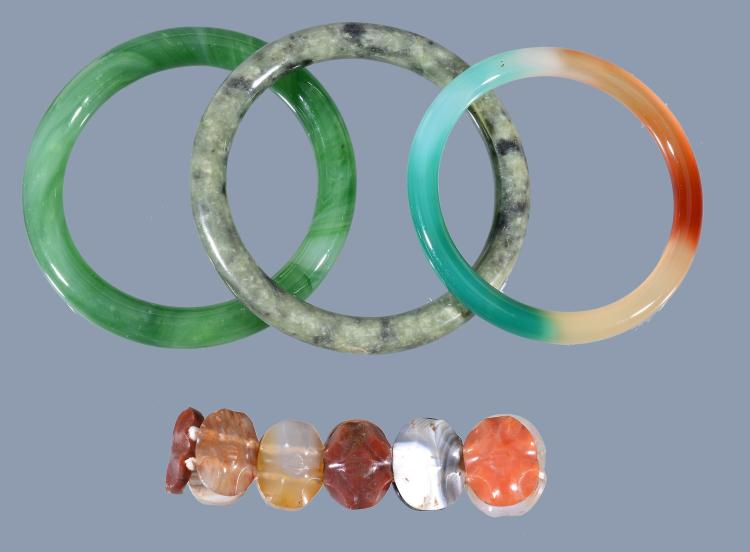 Three Chinese hardstone and jadeite bracelets