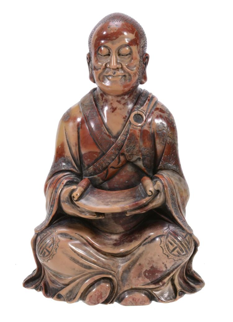 A Chinese soapstone figure of a seated Monk