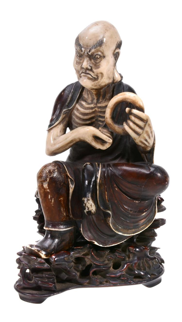 A Chinese painted soapstone figure of a seated Lohan