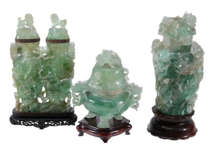 A Chinese green quartz or beryl vase and cover , supported on three feet