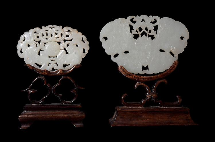 A Chinese white jade plaque, Qing, carved on each side with bats