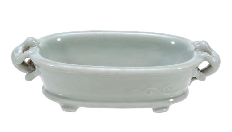 A Chinese celadon 'Lizard' oval censer or small bowl, with pale celadon glaze