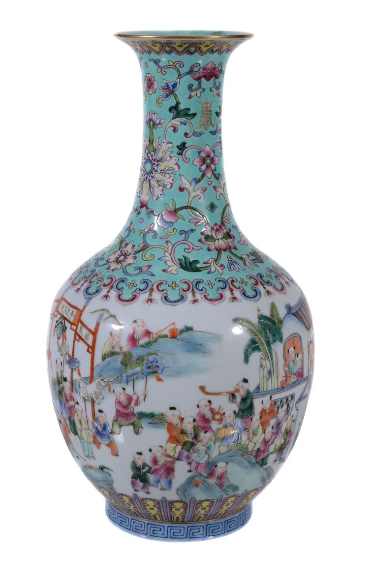 A Chinese Famille Rose þstival' vase , painted with a continuous scene of...
