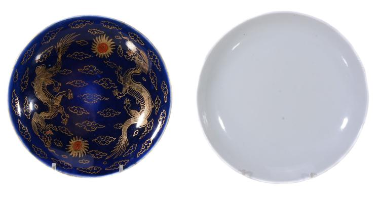 A Chinese porcelain iron-red dish, the exterior with scrolling foliage