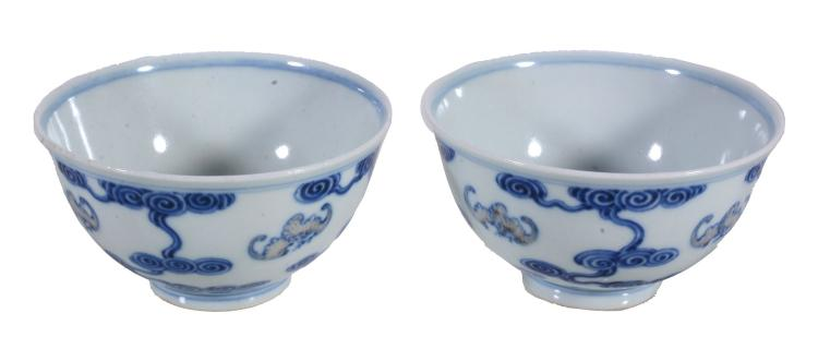 A pair of Chinese 'Cloud and Bat' Bowls, painted around the exterior bats...