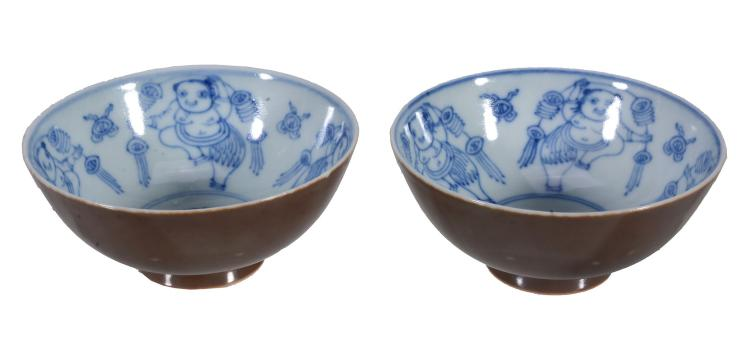 A pair of Chinese blue and white bowls , painted to the centre with four...