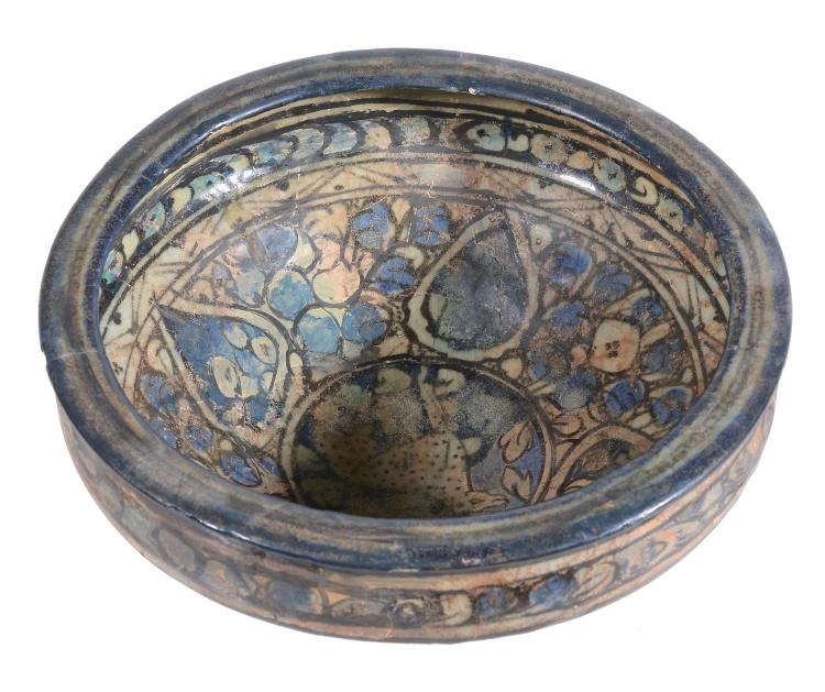 A Sultanabad Bowl, 14th Century, the conical bowl rests on a narrow foot and...