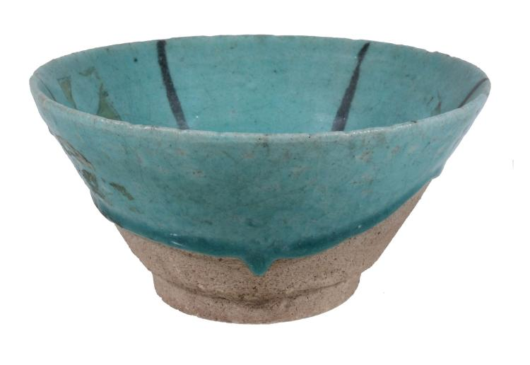 A Kashan Bowl, 12th Century, the heavily potted vessel of flat-bottomed...
