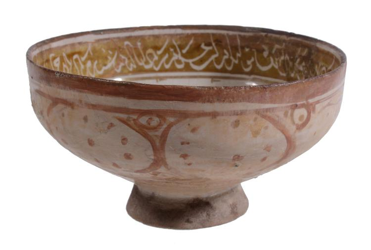 A Kashan Lustre Cup, 12th Century, the rounded bowl raised on a tall