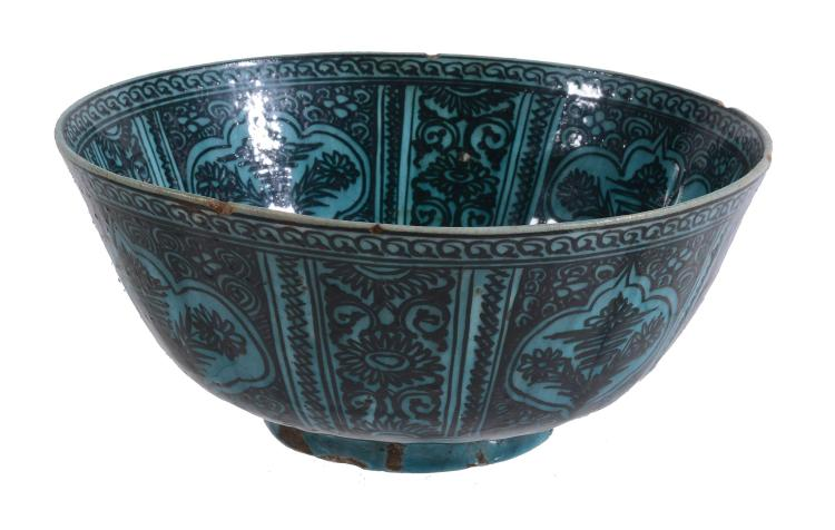 A Large Qajar Bowl, 19th Century, the steep sided vessel resting on a short
