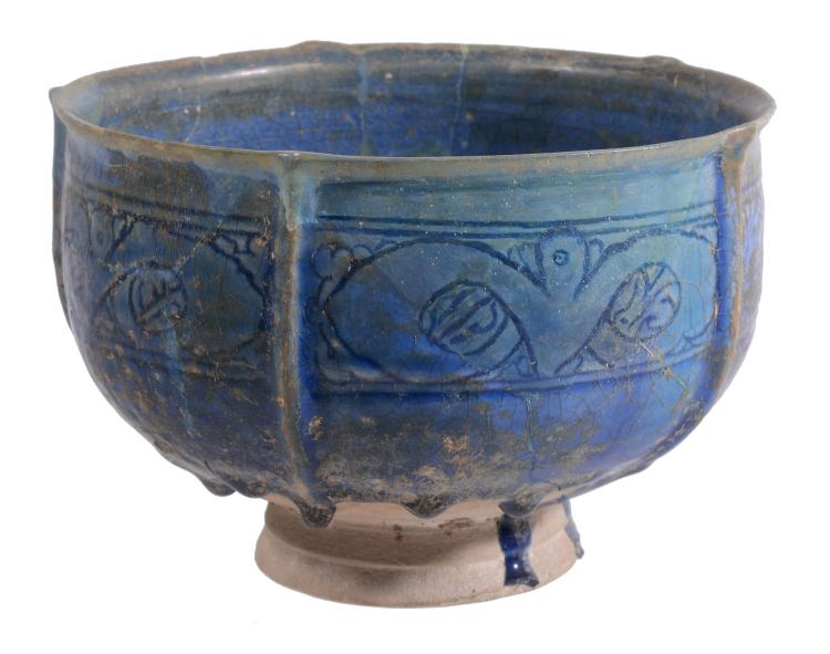 A Kashan Deep Bowl, 12th Century, the five lobed body with slightly everted...