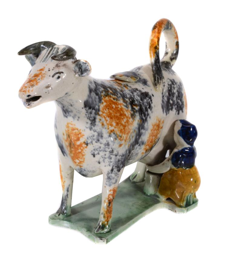 An English creamware cow-creamer and cover of Pratt type, circa 1825