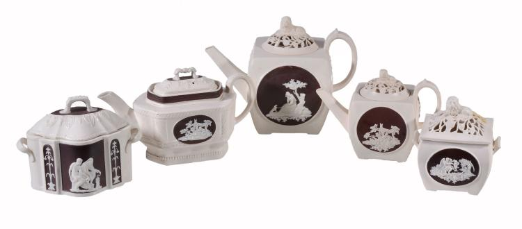 A selection of Turner white felspathic stoneware teawares with brown enamel...