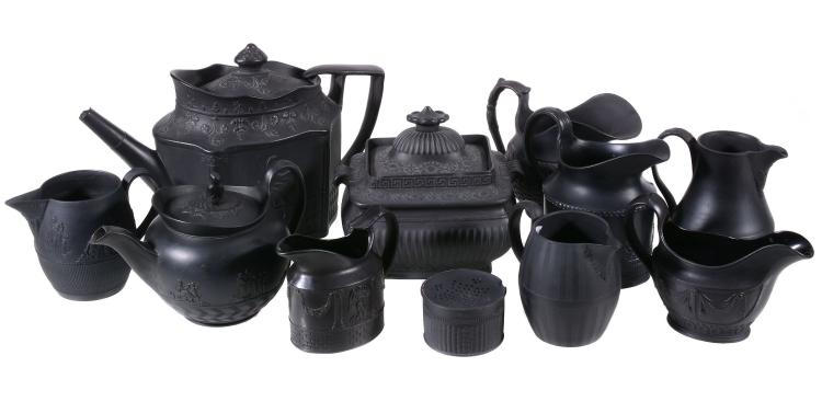 A collection of Staffordshire and South Yorkshire black basalt teawares with...