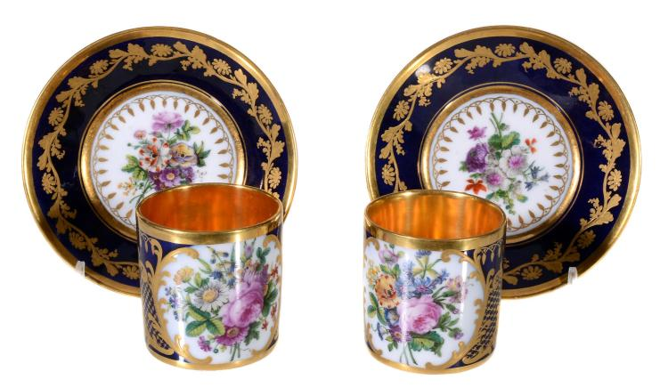 A pair of Paris porcelain blue-ground and gilt coffee cans and saucers