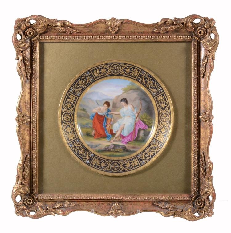 A Vienna-style cabinet plate, circa 1900, painted with a titled classical...