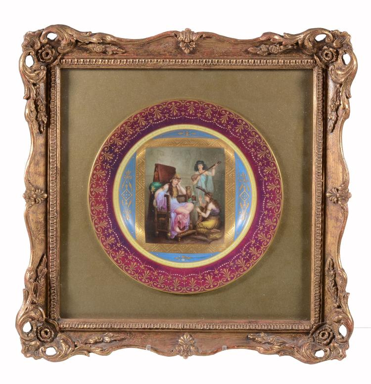 A Vienna-style cabinet plate, circa 1900, printed and painted with an...