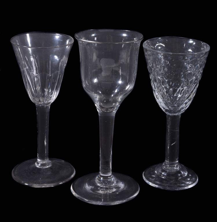 Three various plain-stemmed drinking glasses, comprising