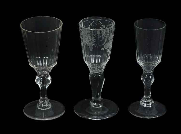 Three Continental fluted baluster wine glasses, mid 18th century