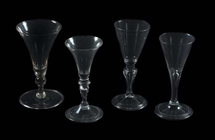 Four various Continental baluster wine glasses, mid 18th century