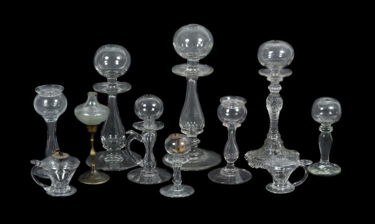 An assortment of mostly French glass oil lamps, 19th century Provenance