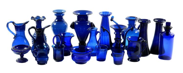 An assortment of mostly French blue glass, mostly 19th century, including jugs